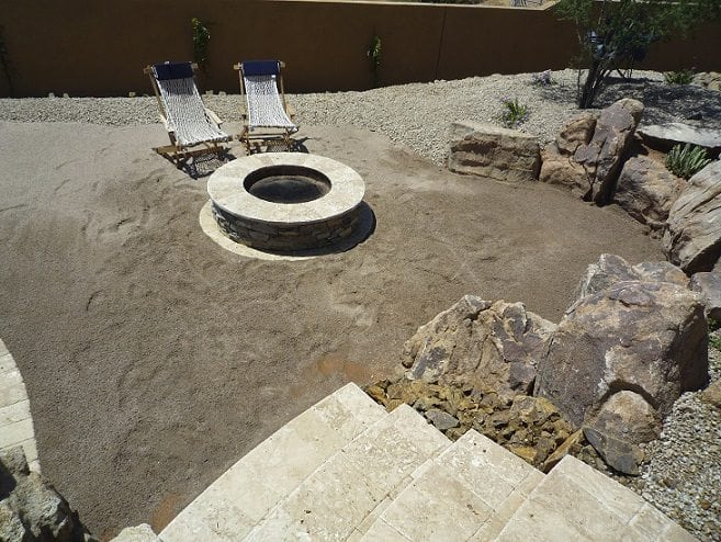 Tucson, Arizona family showing a photo of their fire pit with two lounge chairs around it.