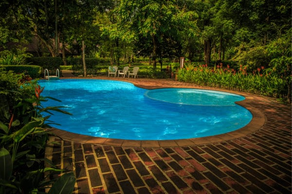 A beautiful swimming pool in Austin, Texas. The swimming pool was built with the help of BYOP.